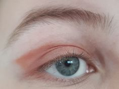 Orangish eyeshadow applied.