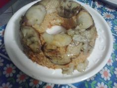 sformato di riso ricoperta da melanzane con cuore filante di mozzarella e pomodorini!
