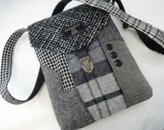 Functional and classy, recycled suit coat purse makes the statement! I designed and made this purse using recycled mens suit coats,the front of the bag has the collar and sleeve section as accents. The back of the purse has the suit vest pocket that can carry your cell for easy access. The purse closes with a flap and a recycled leather tab with a trunk latch. The inside has one button pocket. This is a one of a kind purse sure to impress.    Height: 8.5  Width: 11 Depth 1  Strap 1 wide 50…