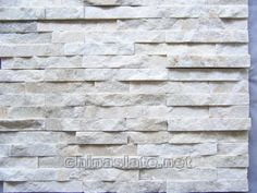 Concept photo: White stacked stone veneer for fireplace surround.