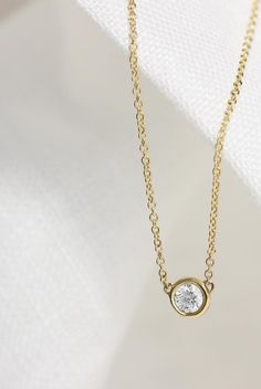 The Solitaire Diamond Necklace features a single, brilliant-cut diamond in a bezel setting that hits at just the right place | Vrai & Oro