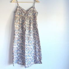 Listing! Floral spring dress Super floral & super light! Tag says size 10, but would probably fit a medium best. In beautiful condition & adjustable straps! Length is 40in. and bust is 17in. H&M Dresses Asymmetrical