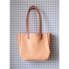Beautiful and supple leather tote with thick vegetable tanned leather handles. This bag has plenty of room for all your every day essentials.