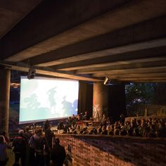Non-profit organisation Assemble constructed a temporary canal-side cinema under a London motorway flyover.