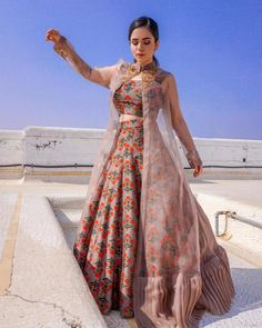 indian designer wear Cream Pink Colour Taffeta Silk Fabric Party Wear Lehenga Choli Comes With Matching Blouse. This Lehenga Choli Is Crafted With Embroidery. This Lehenga Choli Co Indian Fashion Dresses, Indian Gowns Dresses, Dress Indian Style, Indian Designer Outfits, Indian Outfits, Designer Dresses, Indian Fashion Trends, Ethnic Outfits, Indian Attire