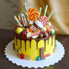 The kind of cake you order on a weekend because kids friends family might just be coming around. Torta Candy, Candy Cakes, Cupcake Cakes, Candy Birthday Cakes, Birthday Cake Girls, Chocolate Explosion Cake, Drip Cakes, Creative Cakes, Chocolate Chip Cookies