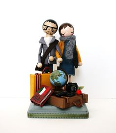 """I JUST DIED. Custom made cake toppers!! Throw a camera on his neck and """"Traveler's Tryst"""" WILL be on my cake!"""