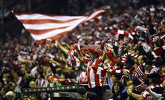 Athletic Bilbao's supporters celebrate as their team won 6-2 against Manchester United's, during their Europa League second leg, round of 16 soccer match at the  San Mames stadium in Bilbao, northern Spain, Thursday, March 15, 2012. (AP Photo/Juan Manuel Serrano Arce)