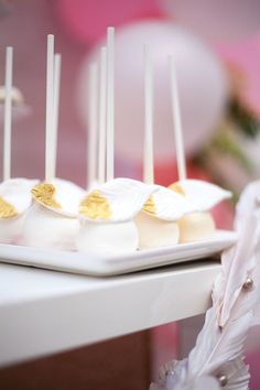 Cake pops adorned with fondant gold-tipped feathers from a Sweet Swan Birthday Party on Kara's Party Ideas   KarasPartyIdeas.com (46)