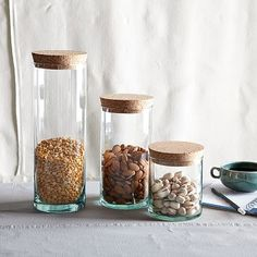 Recycled Glass Containers with Cork Lids @ West Elm ($14- $24)  Read more: http://www.mnn.com/your-home/at-home/blogs/bulking-up-10-countertop-storage-solutions#ixzz3F0WDxM7tBulking up: 10 countertop storage solutions | MNN - Mother Nature Network