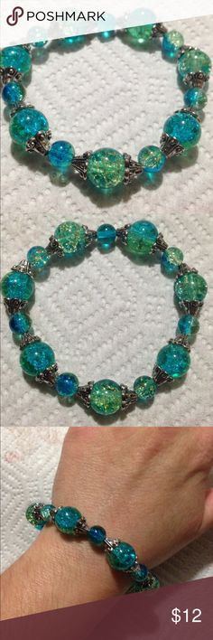 """Blue and Green Glass Bead Elastic Bracelet This pretty bracelet is made with sparkling duotone blue and green glass beads. The circumference is 8"""" and it is elastic. This piece and all PeaceFrog jewelry items are made by me. Take a look through my boutique for coordinating pieces and more unique creations. PeaceFrog Jewelry Bracelets"""