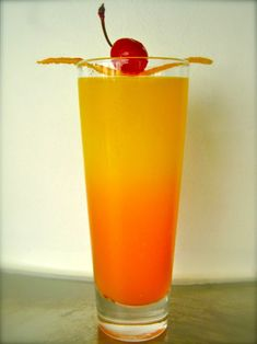 """The Girl on Fire (The Hunger Games cocktail)    Ingredients: 1.5 ounces white rum 3 ounces mango juice 1 to 2 teaspoon grenadine Orange zest strip Maraschino cherry    Directions:From the creator, Khalil Hymore: """"Fill a highball glass with ice. Add white rum and mango juice, then add grenadine, allowing it to sink to the bottom of glass. Do not stir; garnish with orange zest and cherry. Of course, with this drink in hand, there's only one way to toast: May the odds be ever in your favor!""""…"""