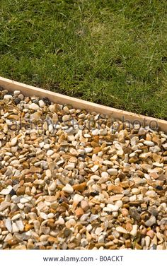 Stock Photo - Gravel path with wooden lawn edging Garden Edging with wood