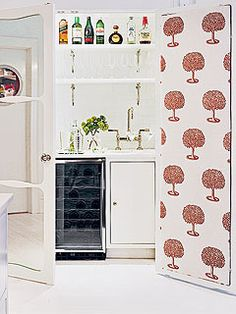 Behind a pair of mirrored doors, a wet bar occupies a former closet. A whimsical wallpaper lines the inside of the doors, creating a charming view whether they are open or closed. Closet Bar, Closet Redo, Closet Doors, Diy Home Interior, Interior Ideas, Closet Conversion, Cottage Kitchens, Amazing Spaces, Cottage Living