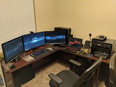 Finally upgraded to legitimate office furniture. The desks wrap around the room. Might mount a TV in the corner.