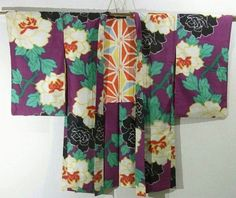This is a vintage Meisen Haori with 'botan'(peony) pattern, which is woven