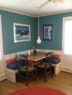Here is a cozy dining banquette with colorful handmade Susan Sargent cushions and artwork by Nielsen's mother, Carol Henrici. I would use bigger pendant that included some of the brighter colors on the cushions.