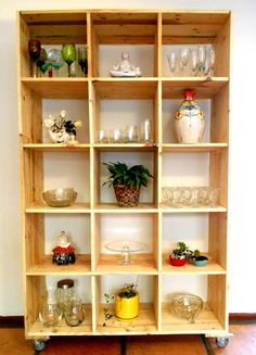 Pallets - Movable storage units made from recycled pallet wood by jasper & george. All ceramics by Maureen Visage