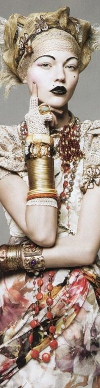 bracelets and waist length necklaces by David Sims