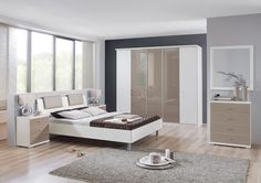 """Porto"" Bedroom Furniture Range. The über cool Porto is the pinnicle of sharp design. The smooth coloured optional  glass finish reflects light as well as impeccable taste.  The city chic cabinets, in white, a Virginia oak or American walnut effect are set off by  smooth glass doors available in white, sahara or black. Alternatively you can choose solid fronts to match your carcase. The integral headboard on the matching bed features individual headboard pads in either sahara, white…"