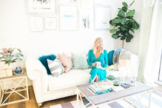 Blogger McKenna Bleu's living room, featuring a gorgeous gallery wall and coastal vibes!