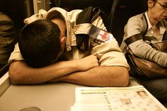 Tired soldier in the train.