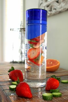 Fat Burning Detox Water - 1 strawberry, sliced - 1/2 small cucumber, sliced - 1/4 grapefruit, sliced into triangles - ice water to fill