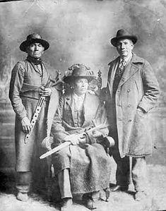 Red Blanket, Ojibway chief of the Leech Lake band,  John Bassett, Ojibway interpreter, and unknown man.  ca. 1895
