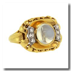 Circa 1940-50s, 18k, MEISTER. This cool fifties ring is set with a 2.55 carat luminescent blue moonstone and brilliant white diamonds. The hand fabrication is superb and the retro styling vintage chic. Excellent condition.