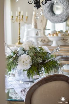 icy-blue-and-white-christmas-dinner-table-ideas-with-deer Christmas Floral Arrangement with Cut Greenery Garland And Ornaments