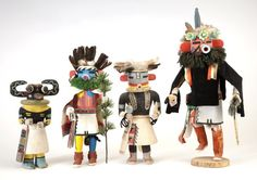 """Exhibition """"Hopi Katsina Dolls: 100 Years of Carving"""" On the Far left: James Kootshongsie (Jimmy Koots), 1916-c. 1996 Hoote, 1955-1960 Originally the ruffs on katsina carvings were Douglas fir. This was a very fragile material that dried and broke. In the early 1960s, carvers began shaping a rounded wood ruff painted solid green. Gift of Joann Phillips, 4374-58"""