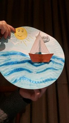 Early Learning Craft Early Learning Craft Paper plate sea and moving boat scene Arts and Crafts workshop at Tilkin-Dilkin Studio The post Early Learning Craft appeared first on Craft for Boys. Preschool Arts And Crafts, Daycare Crafts, Sunday School Crafts, Paper Crafts For Kids, Craft Activities For Kids, Toddler Crafts, Preschool Transportation Crafts, Transportation Unit, Childcare Activities