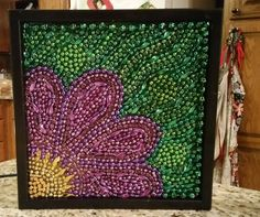 Mardi Gras Bead upcycle by https://www.facebook.com/No-Grout-About-It-Mosaics-by-Kat-1575867549330840/