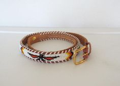 Vintage 1970s Boho / Thin Tooled Leather & Seed Bead Souvenir Belt from Velouria Vintage. Saved to Velouria Vintage Shop Items. #vintage.