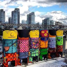 "Street art | Mural (Vancouver, Canada, 2014) by Os Gemeos. Brazilian street artists twins ""Os Gemeos"" paint six enormous silos."