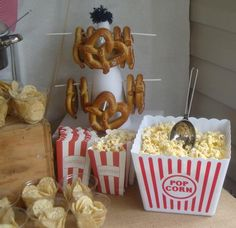 food ideas for sports party.  We have a few popcorn bins like this.  Seems to me I saw some disposable ones at Hobby Lobby.