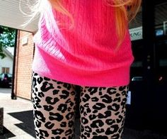 Cheetah leggings and pink sweater! <3 I would need that to be a long enough sweater to cover my behind, but I would totally rock this look...
