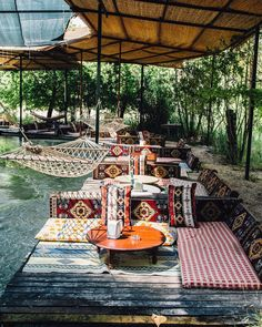 Hammocks and cozy pillows at cafe along the river running through Saklikent Gorge in Turkey