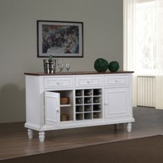 @Overstock.com - Complete the look of your living space with this elegant Country buffet. This buffet features two wood doors, three drawers, and twelve wine cubbies.http://www.overstock.com/Home-Garden/Country-2-door-Buffet/6517150/product.html?CID=214117 $407.99