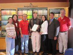 Danny Goetze, Owner of Village Paint Supply (Third on Left) celebrates the stores 50th Anniversary with his staff and local officials