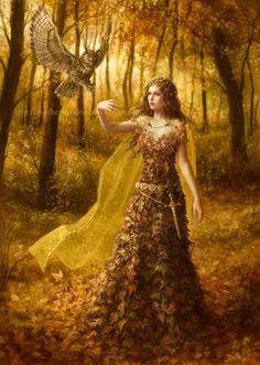 un buho posando sobre la mano de un a especie de mujer de el otoño