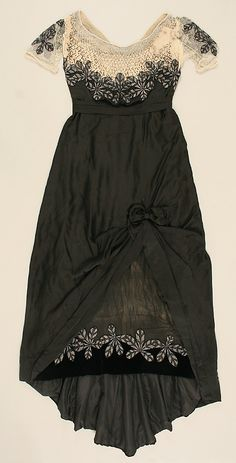 Dress, Evening.  House of Worth(French, 1858–1956).  Date: ca. 1911. Culture: French. Medium: silk, beads, stones, simulated pearls. Dimensions: Length at CB: 64 in. (162.6 cm).