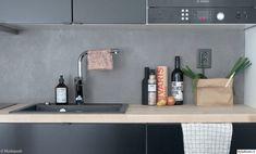 mikrosementti,välitila,keittiö,remontti,moderni keittiö,betoni,keittiön pikkutavarat,pesuallas,keittiön tasot,harmaa,moderni