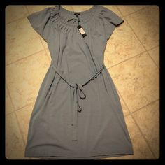 Reposh Cute Gray Dress I bought this hoping it would be a cute throw on and go dress but I am a little too curvy and short for it.  It's 95% rayon and 5% spandex so it has stretch.  It's a great comfy dress for someone taller than 5'3. Talbots Dresses