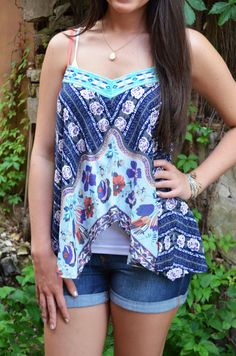 Floral Angle Top :: $29.99 :: www.ShopGroovys.com :: angled hem line, tribal trim, multiple floral prints