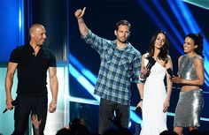 Costar Love Walker and his Fast and the Furious costars Vin Diesel, Jordana Brewster, and Michelle Rodriguez speak onstage during the 2013 MTV Movie Awards at Sony Pictures Studios on April 14, 2013