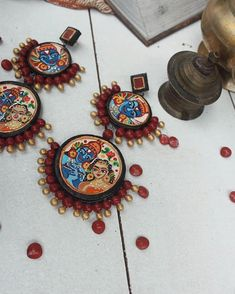 These Trendy And Stunning Terracotta Jhumkas Are For The Quirky Bride-To-Be. For more such wedding jewellery inspirations, stay tuned with shaadiwish. Unique Earrings, Unique Jewelry, Jewelry Design, Silver Jewelry, Terracotta Earrings, Terracotta Jewellery, Bridal Accessories, Wedding Jewelry, Wedding Jewellery Inspiration