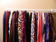 Closet organization for scarves with a curtain rod and shower rings