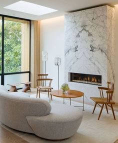 Love Interior Design Idea - 7 Ways To Bring A Touch Of Marble To Your Living Room // Marble Fireplace Surround