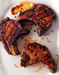 Find the recipe for Grilled Giant Pork Chops with Adobo Paste and other herb recipes at Epicurious.com